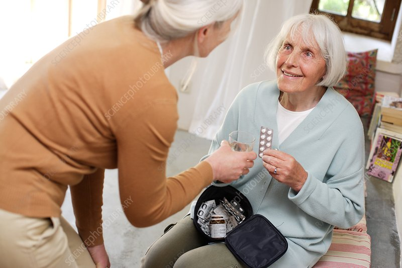 Woman helping elderly woman