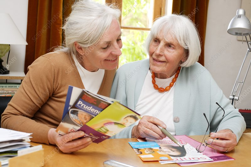 Elderly woman reading leaflet