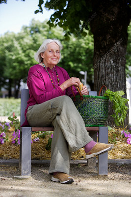Elderly woman on a bench