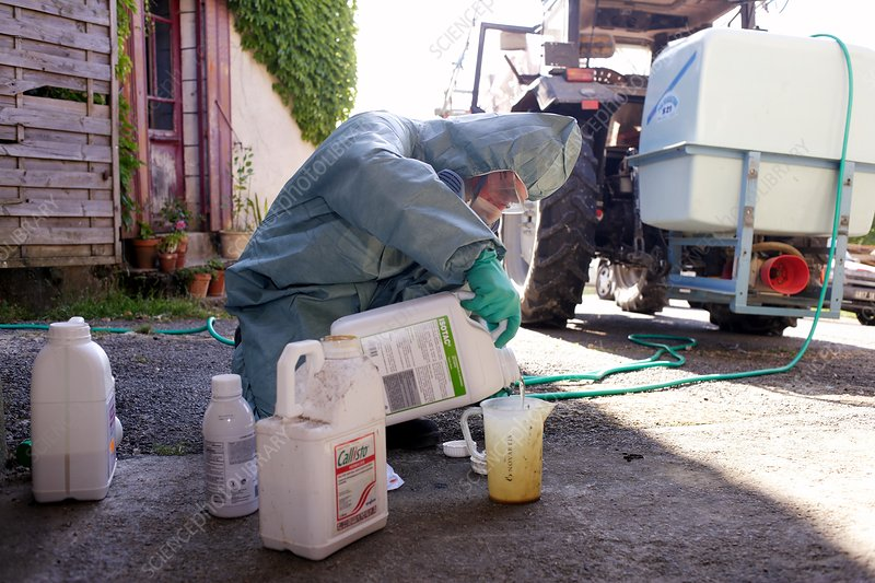 Farmer mixing chemicals