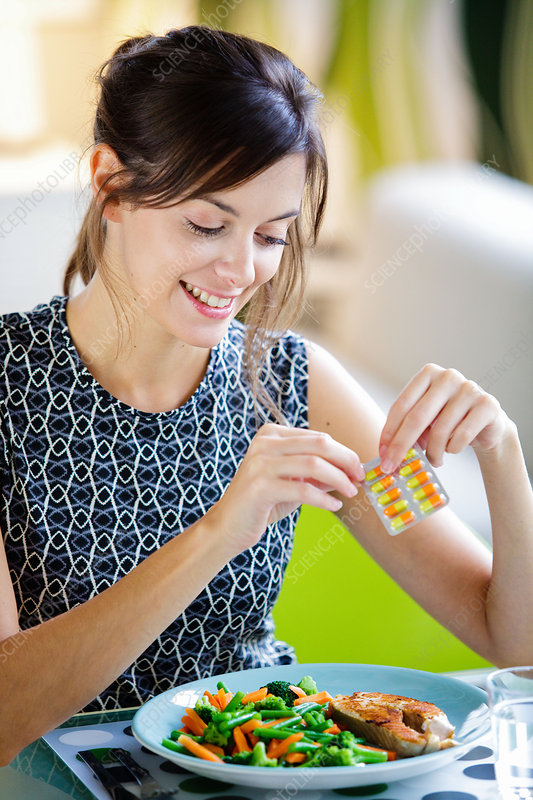 Woman taking medication