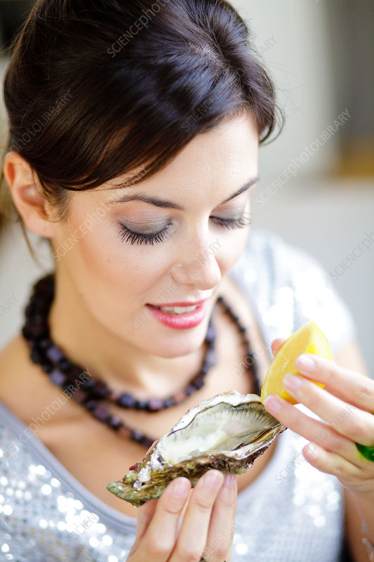 Woman eating oyster
