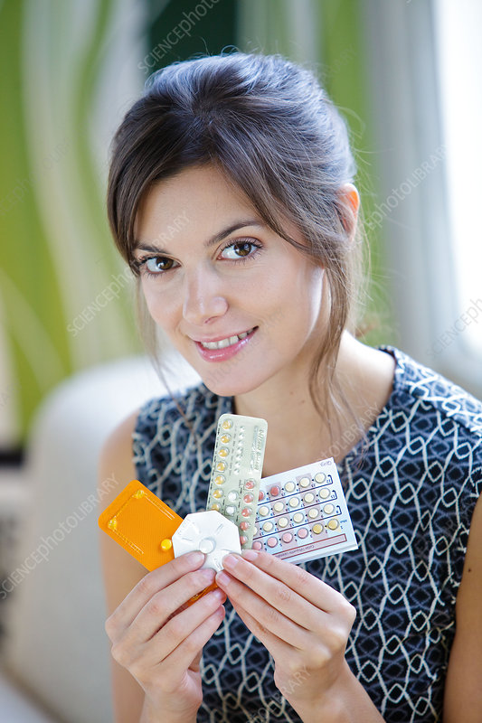 Woman with contraceptive pills