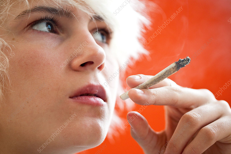 Teenager smoking marijuana