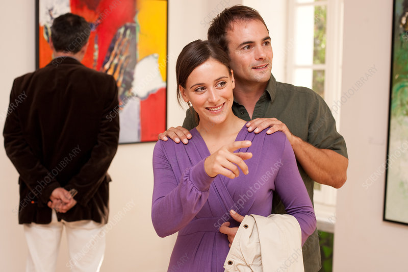 Couple in art gallery