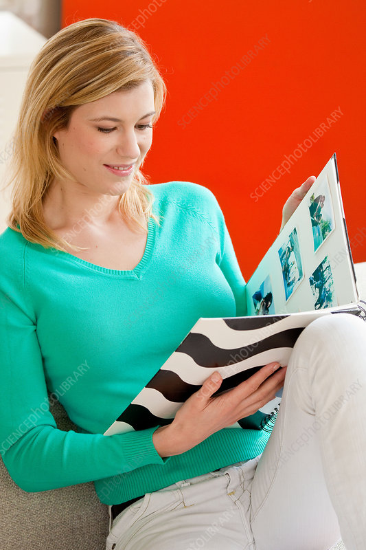 Woman looking at photo album