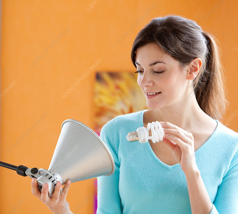 Woman changing bulb