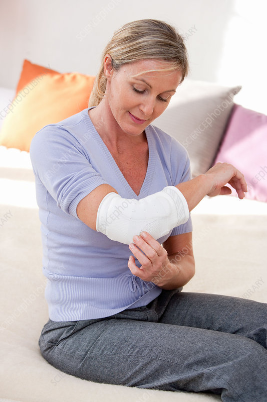 Woman wearing elbow support