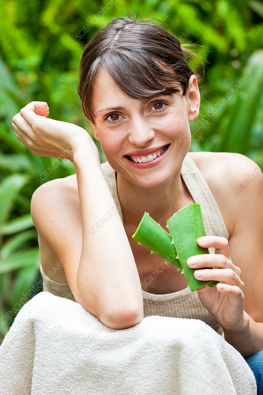 Woman applying aloe vera