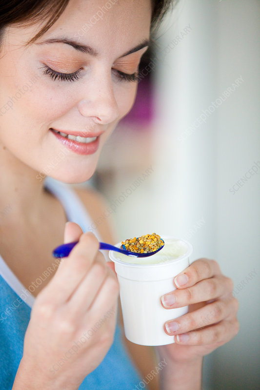 Woman eating pollen