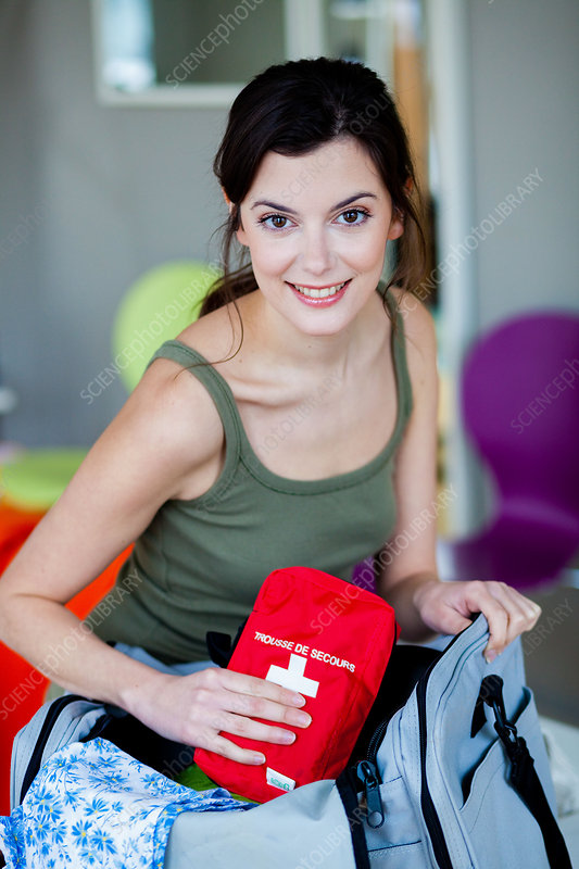 Woman preparing first aid kit