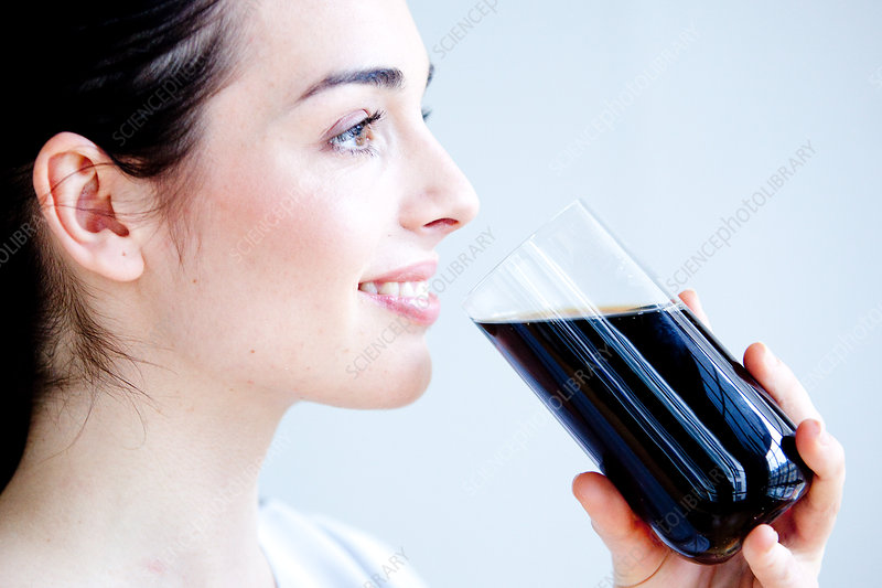 Woman drinking a soda