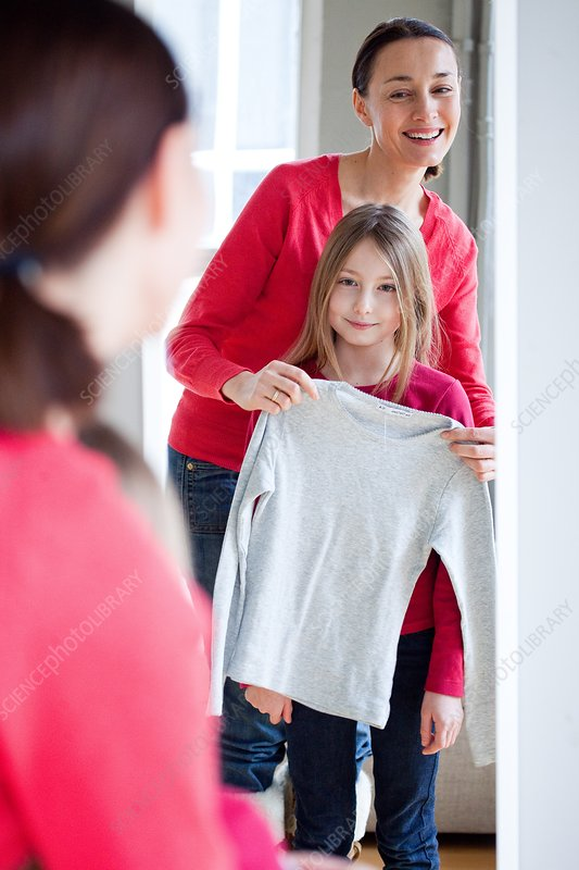Girl and mother with clothes