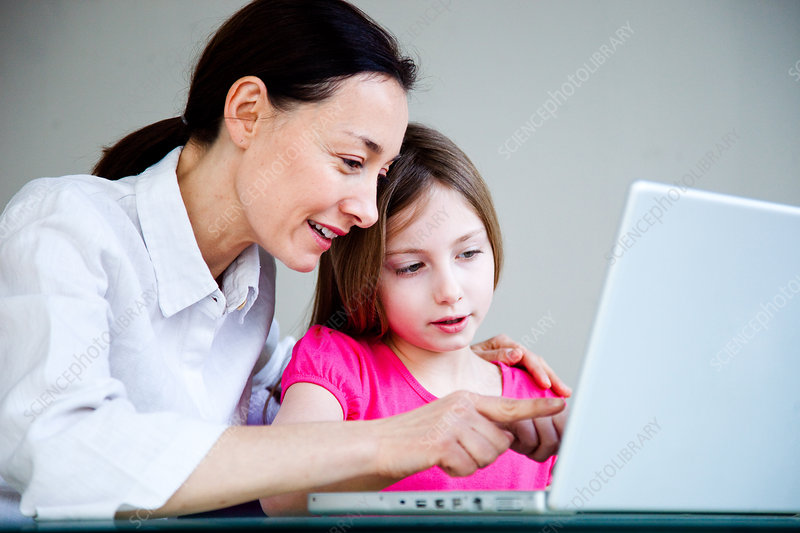 Mother and child using laptop computer