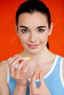 Woman taking homeopathic medicine
