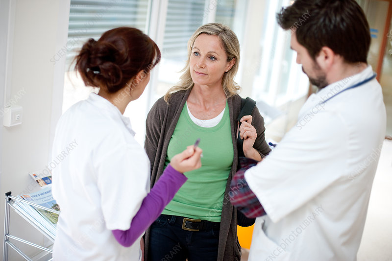 Woman talking with medical staff