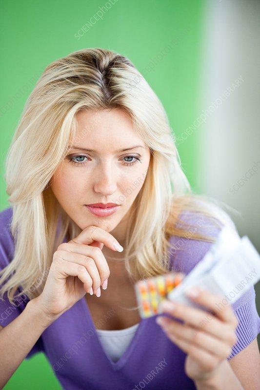 Woman looking at medicine