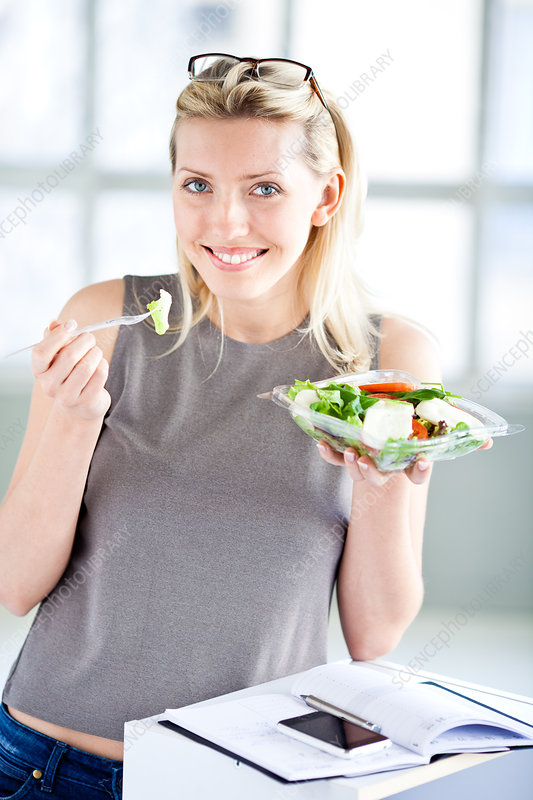 Woman eating tomato salad