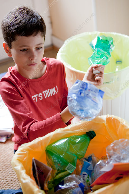 Boy recycling waste