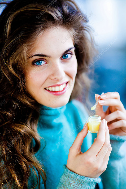 Woman eating royal jelly