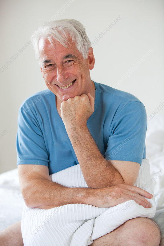 Smiling senior man in bed