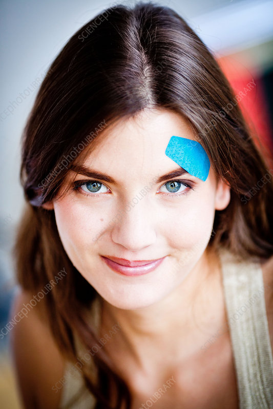 Woman applying band-aid