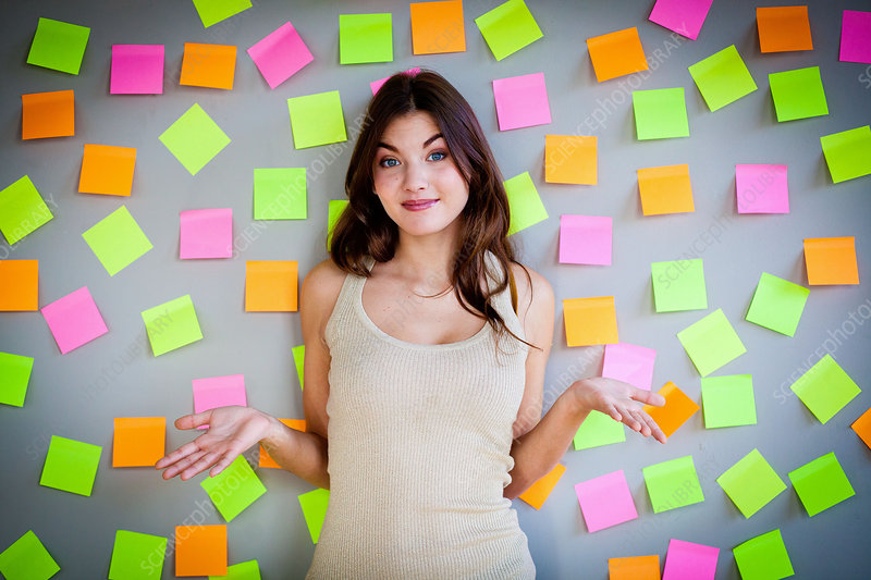 Woman surrounded by post-it notes