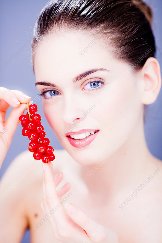 Woman eating red currants
