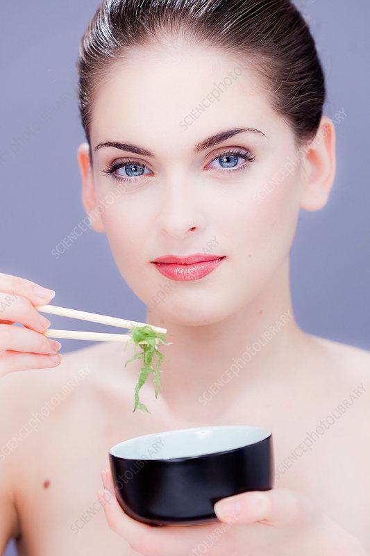 Woman eating edible seaweed