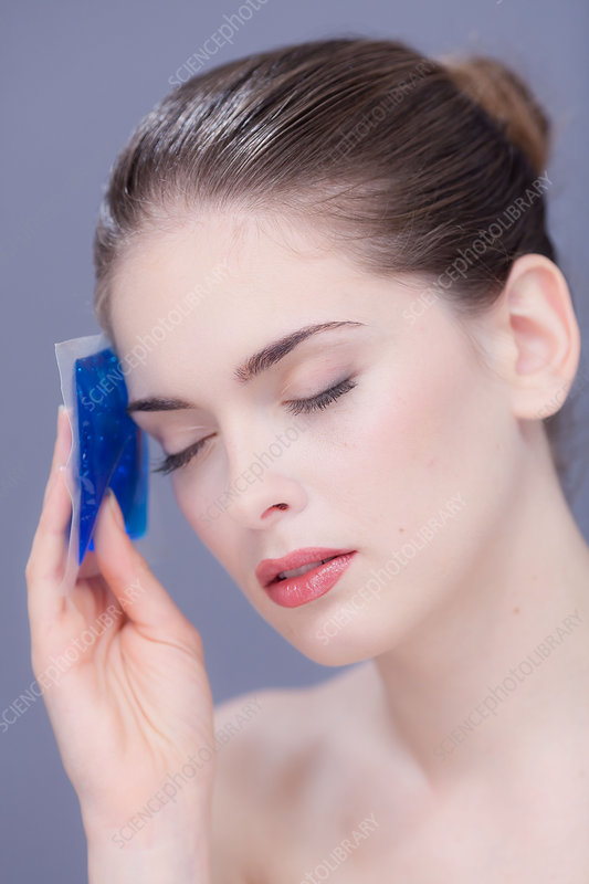 Woman using a gel pack