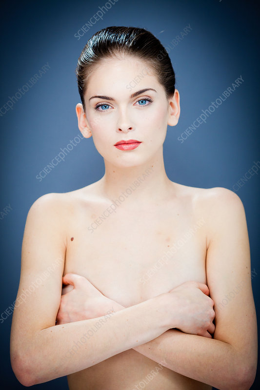 Woman hiding her breasts