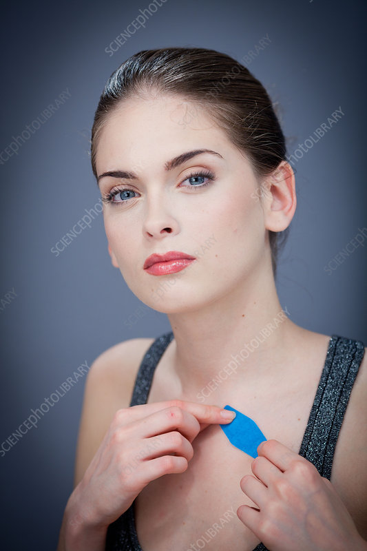 Woman putting a band-aid