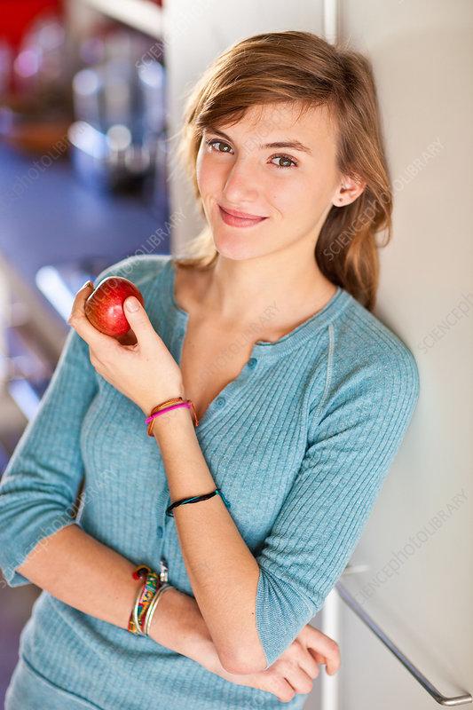 Teenage girl eating apple
