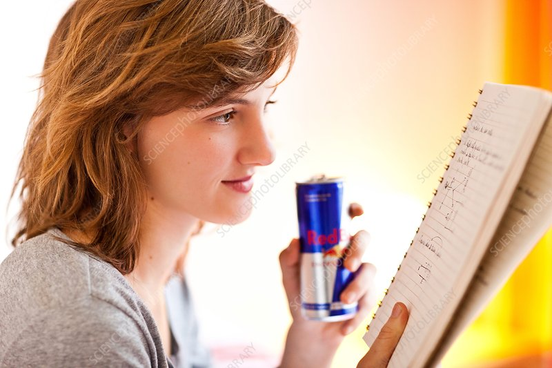 Teenage girl drinking energy drink
