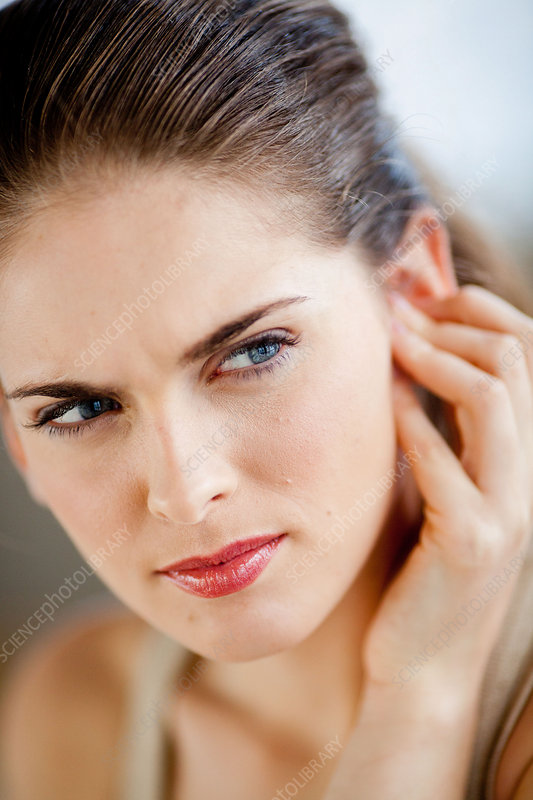 Woman with painful ear