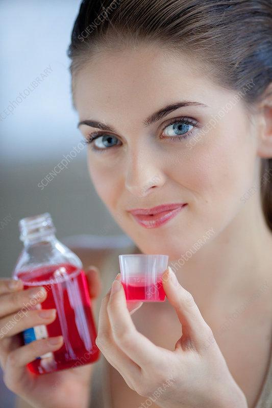 Woman having a mouthwash