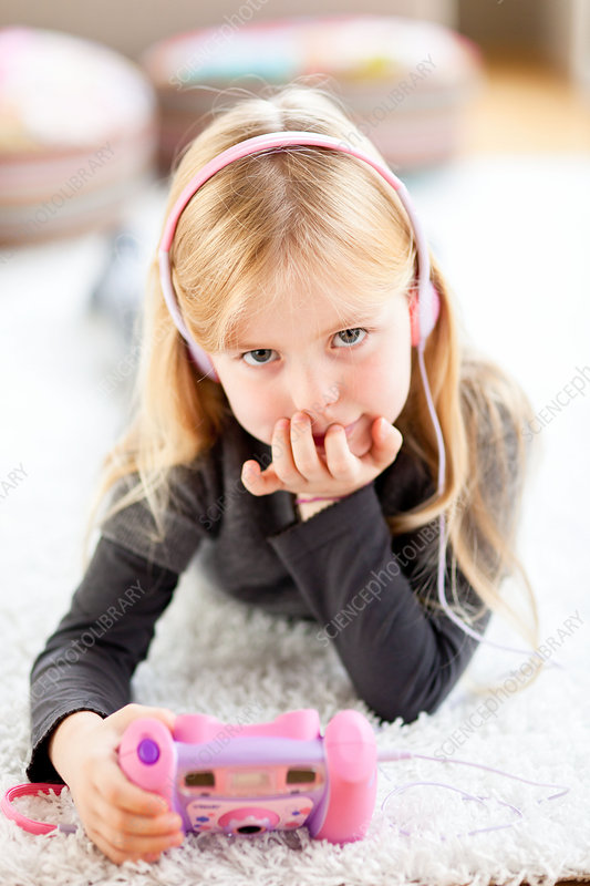 7 year old girl listening to music