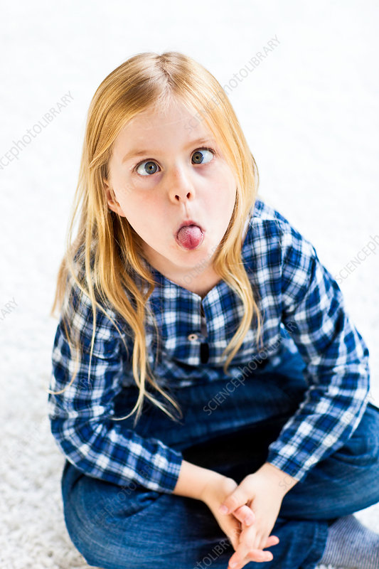 7 year old girl making funny faces