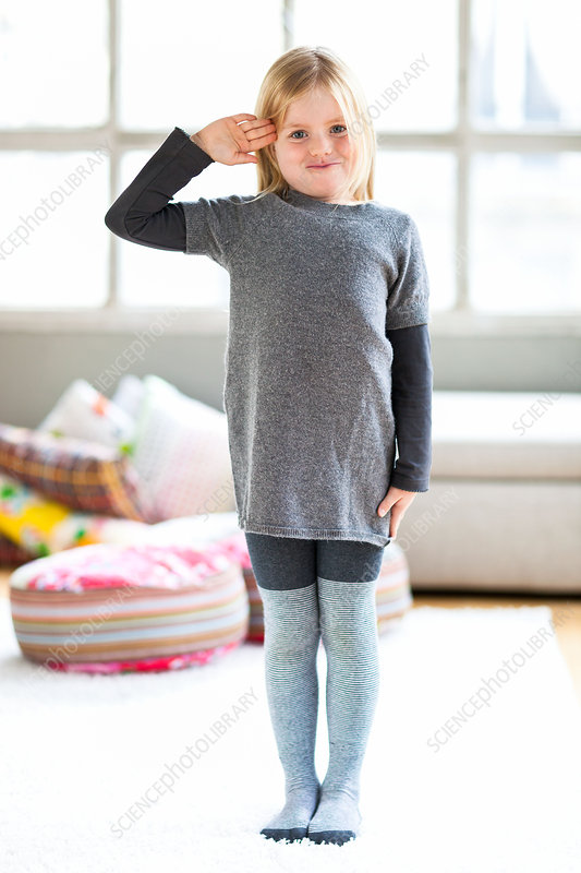 7 year old girl standing at attention