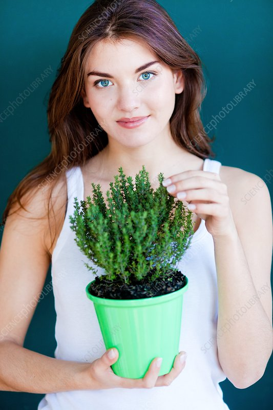 Woman inhaling thyme fragrance