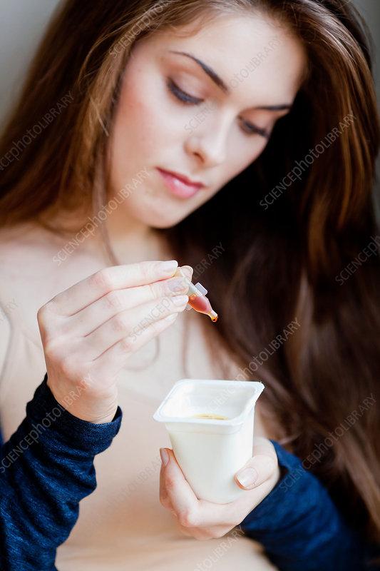 Woman taking propolis