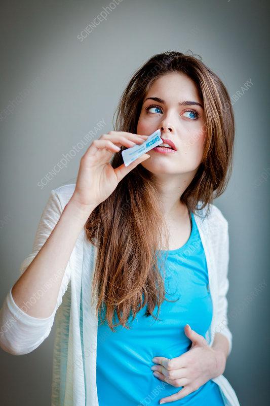 Woman taking gel medicine