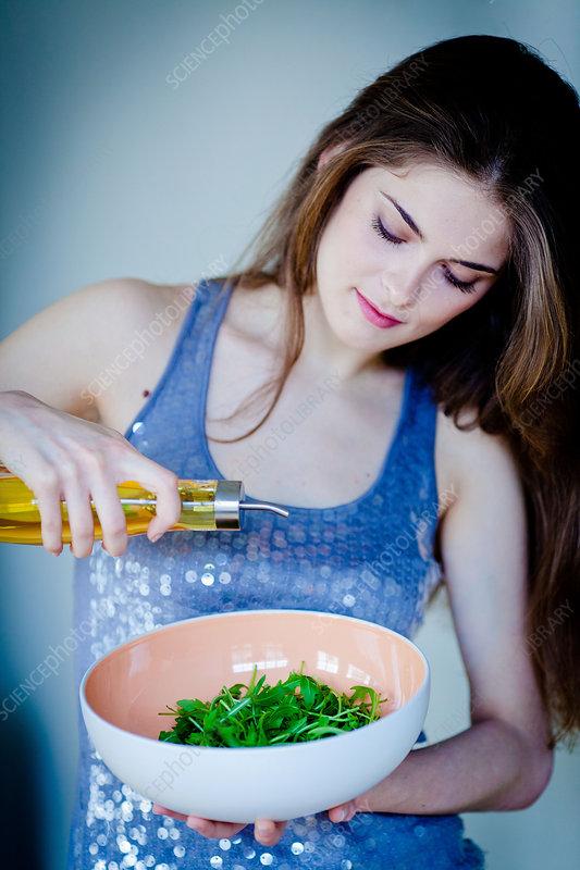 Woman using walnut oil