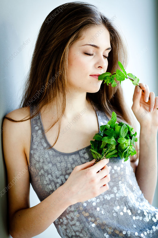 Woman smelling mint
