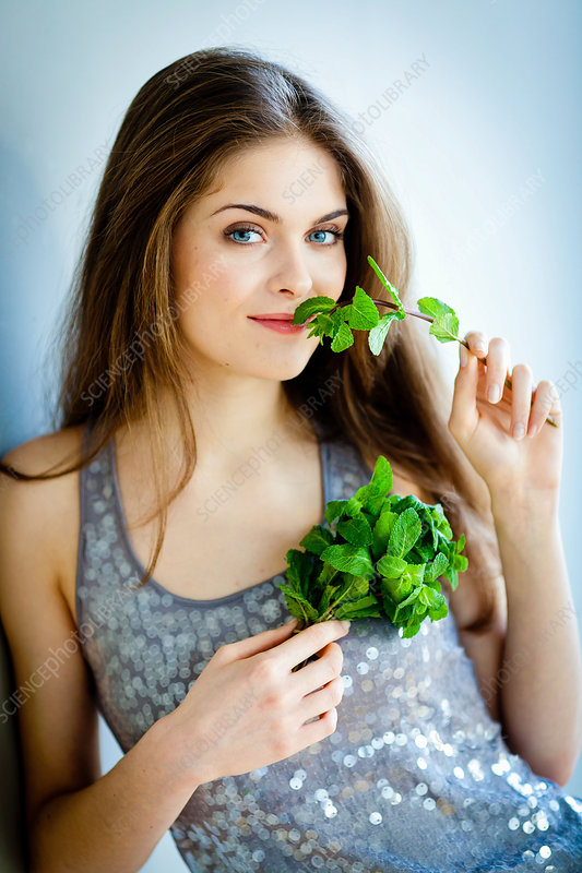 Woman smelling mint
