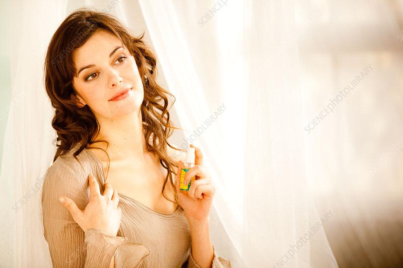 Woman applying spray