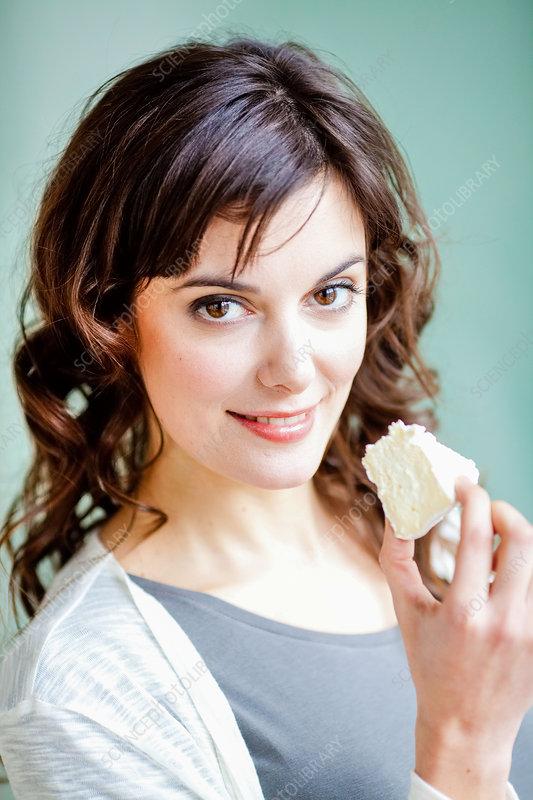 Woman eating Camembert
