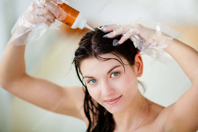 Woman applying hair colour shampoo