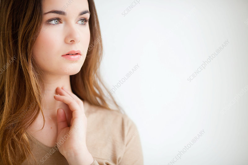 Woman self-examining her throat