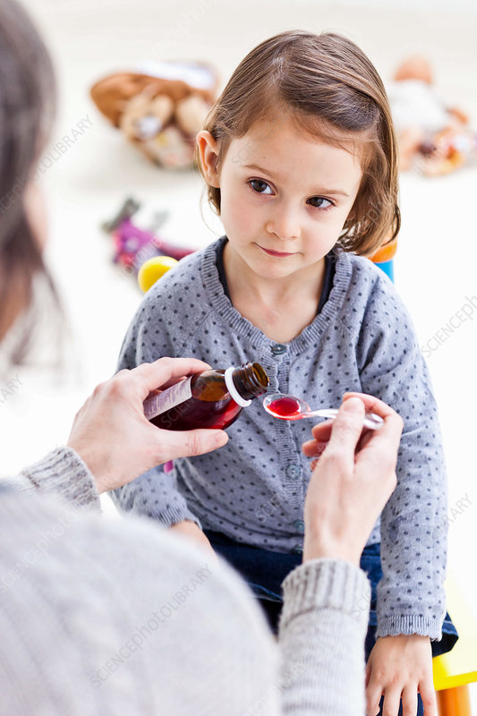 Child taking syrup